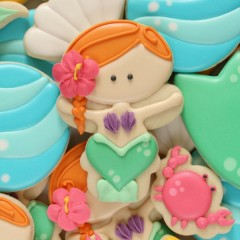 Learn to make mermaid cookies with a Wilton Snowman cutter at Sweetsugarbelle.com