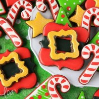 Christmas Santa belt buckle cookies featuring Lila Loa Cookies via Sweetsugarbelle.com